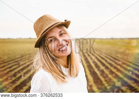 Beautiful Woman Walking In Nature. Happy People Lifestyle. Woman Smiling While Walking In Field. Nat