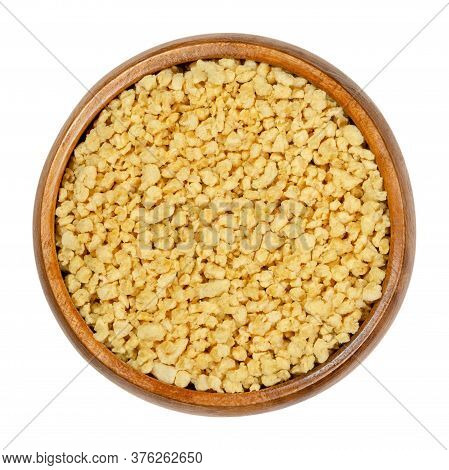 Soya Granules In Wooden Bowl. Textured Soy Protein, Also Called Soy Meat. Defatted Soy Flour Product