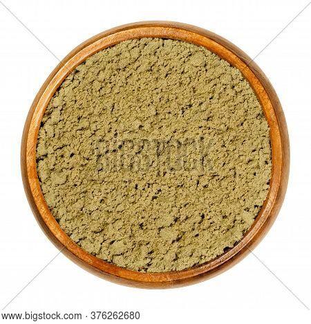 Hemp Protein Powder In Wooden Bowl. Ground Seeds Of Cannabis Sativa. Gluten Free Dietary Supplement