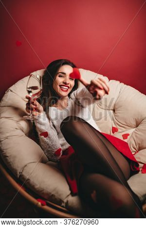 Laughing Lovable Woman With Wineglass Having Fun In Studio. Carefree Female Model In Black Pantyhose