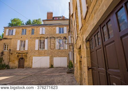 Sarlat-la-Caneda, France - August 11, 2019: Historic houses in Sarlat la Caneda in Dordogne Department, Aquitaine, France