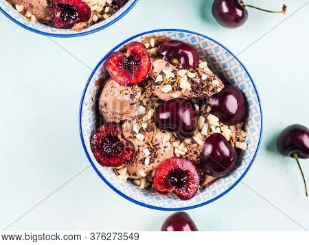 Chocolate Ice Cream Sundae With Cherries In Blue Bowls, Almond And Chocolate Sprinkles On Green Turq