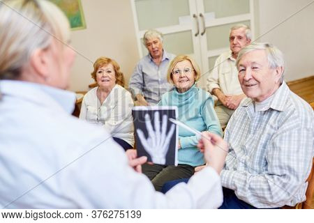 Doctor takes a health course for senior citizens in a retirement home or retirement home