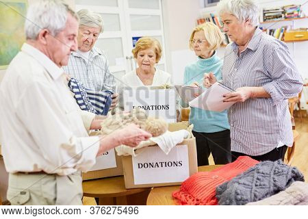 Group of seniors collects clothing donation in the old people's home for the needy