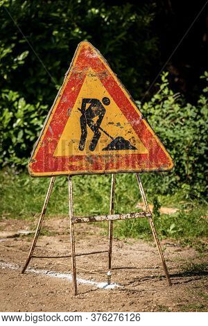 Work In Progress, Closeup Of An Old Triangular Road Sign On The Roadside. Italy, Europe