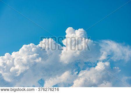 Closeup Of A Puffy White Clouds In The Blue Sky, Cumulonimbus