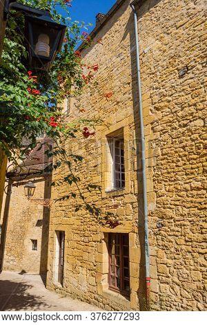Sarlat la Caneda, France - August 11, 2019: Historic houses in Sarlat la Caneda in Dordogne Department, Aquitaine, France
