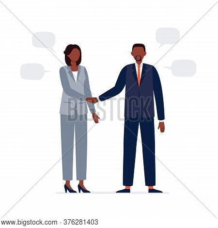 An African-american Man And Woman Are Shaking Hands. Two Politicians In Official Suits Have A Busine