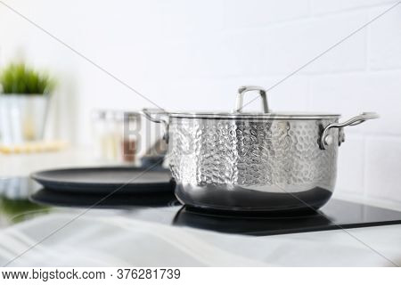 New Shiny Saucepan On Stove In Kitchen