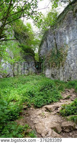 Rocky Footpath Through A Narrow Canyon In The Forest Of Ebbor Gorge National Nature Reserve. Wookey