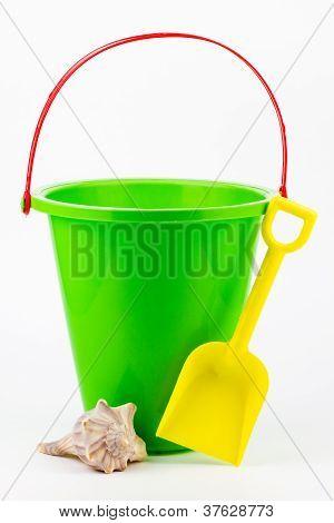 A Sand Bucket, Shovel, And Seashell.