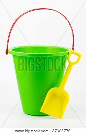 A Sand Bucket With A Shovel.