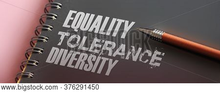Equality Tolerance Diversity Words On Page Of Copybook And Pen. Social Concept.
