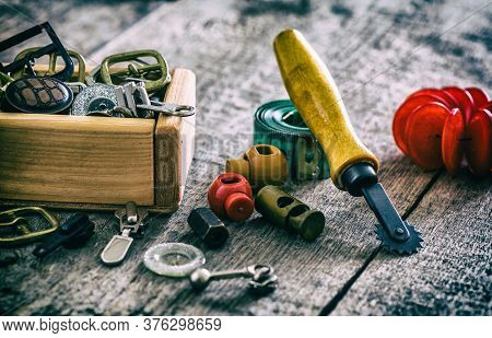 Creative Image Of Sewing Fittings And Accessories For Sewing Clasps, Clamps, Buttons On The Old Wood