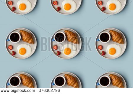 Pattern With Breakfast On Plate. Black Coffee, Croissant, Fried Egg With Yolk And Strawberry On Gray