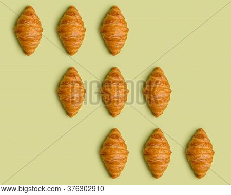 Pattern With Croissants At Minimal Light Green Background. Diagonal Lines Of Croissants. Top View, F