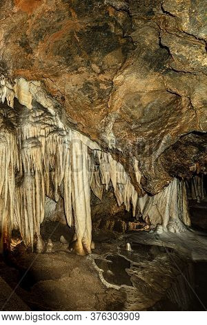 Close-up Of A Mountain Cave With Stalactites And Stalagmites In Tuscany, Italy, Europe