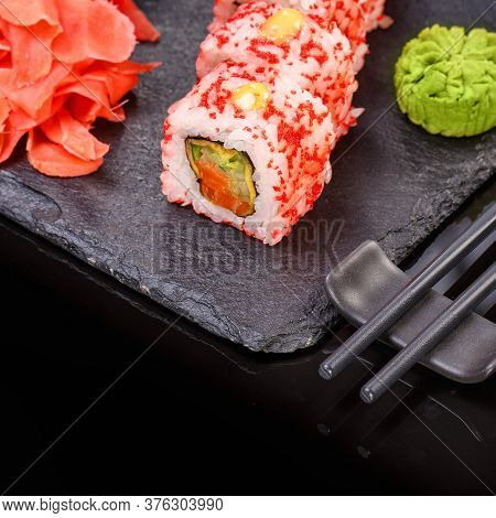Sushi Roll With Seafood And Soy Sauce, Wasabi And Ginger.