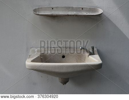 Old Washbasin That Is Broken Doesn't Work.