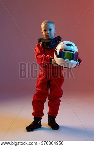 Cool Boy Child Racer With Helmet, Standing In Neon Light. Kart Racing School Poster. Competition Ann