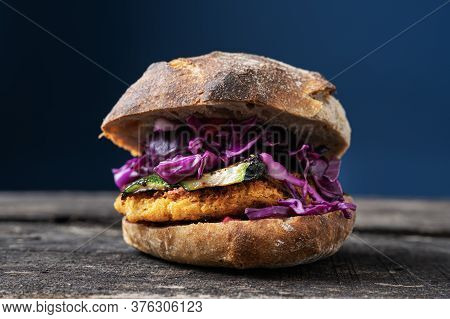 Vegan Burger  With Grilled Zucchini And Red Cabbage In Sourdough Bun