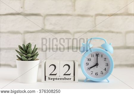 September 22 On A Wooden Calendar Next To The Alarm Clock.september Day, Empty Space For Text.calend