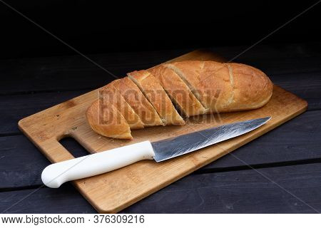 Loaf Of Bread With A Knife.loaf Of Bread With A Knife