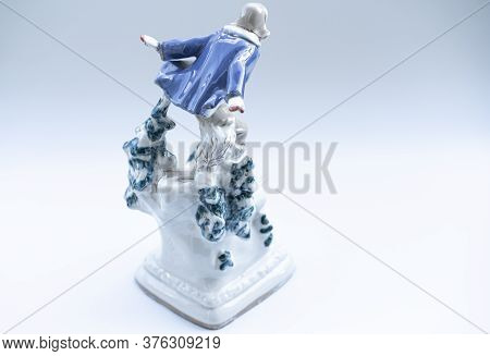 Porcelain Figurine On A White Background.porcelain Figurine On A White Background.