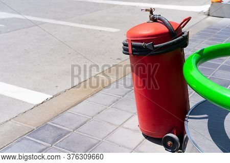 Red Gas Cylinder With A Hose.red Gas Cylinder With A Hose