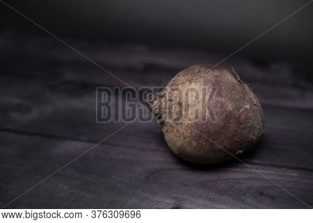 Beetroot Lies On A Wooden Background.beetroot Lies On A Wooden Background