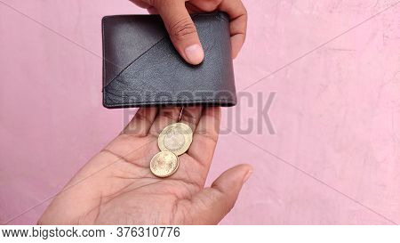 People Are Facing Economic Downturn. No Money In The Wallet Only Coins Left As A Poor Broke Man.