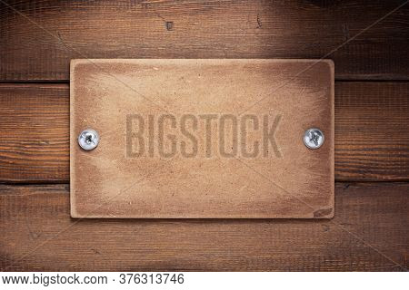 aged wooden signboard or nameplate on board bar background