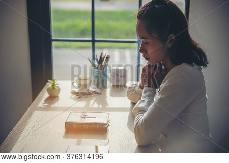 Prayer And Bible Concept. Asian Woman Praying, Hope For Peace The World And Free From Coronavirus, H