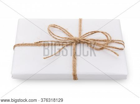 Gift Box Wrapped With White Paper On A White Background.