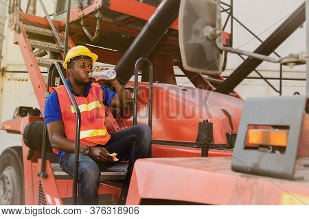 Enginneer, An African American Industrial Worker Wearing Safety Work Clothes, Take A Break, Sit, Eat