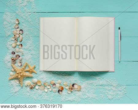 Summer Template. Travel Planning. Notepad And Pen, Small Seashells, Starfish And Sea Salt On Turquoi