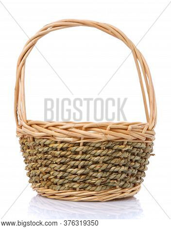 Basket Woven In Two Colors From A Natural Vine Isolated On A White Background.