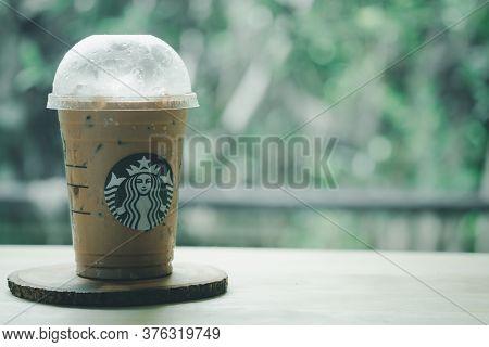 Bangkok, Thailand - July 14, 2020 : Iced Mocha In Takeaway Glass From Starbucks Coffee Shop On Wood