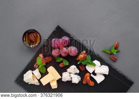 Wine Appetizer Plate With Different Cheeses, Dor Blue, Brie, Parmesan
