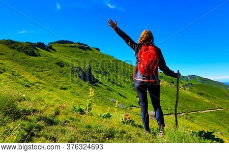 woman hiking on the mountain in France, Cantal