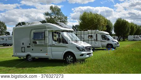 St Neots, Cambridgeshire, England - July 04, 2020: Two Large Camper Vans On Campsite.