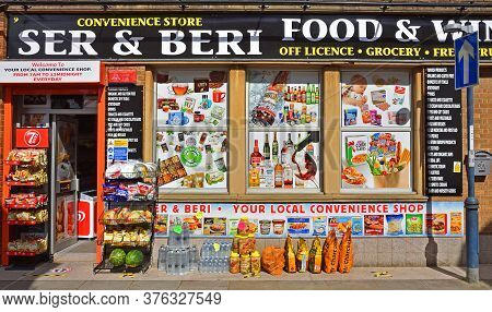 St Neots, Cambridgeshire, England - July 04, 2020:  Convenience Store Front With Advertising And Pro