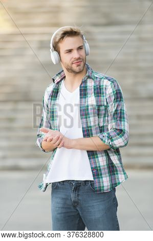 Feel The Sound Closely. Handsome Man Listen To Sound Track Outdoors. Young Guy Wear Headphones. Hi-f