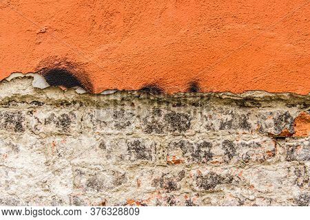 Close Up Shot To A Corroded Orange Wall Texture With Bricks