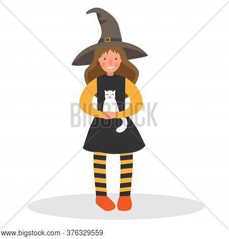 Girl In A Witch Costume With A White Cat. Girl In A Hat And Striped Tights. Witch Costume For Hallow
