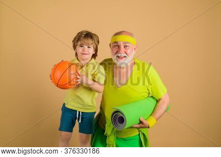 Family Time Together. Family Sport. Portrait Of A Healthy Grandfather And Son Working Out. Family Ti