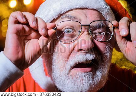 Santa Holds Broken Eyeglasses. Christmas. Santa Man With Broken Glasses. Surprised Santa Holds Broke