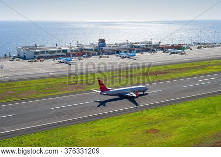 Aerial View Of Funchal International Airport With Planes By Terminal Building, Airplane Taking Off A