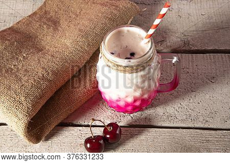 Bocal Of Milkshake Cocktail On A Wooden Background. Exotic Summer Drinks On Beach Table