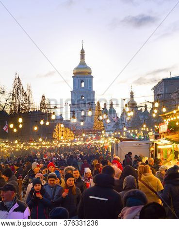 Kiev, Ukraine - January 06, 2020: People Attending New Year And Christmas Market In An Old Town Of K